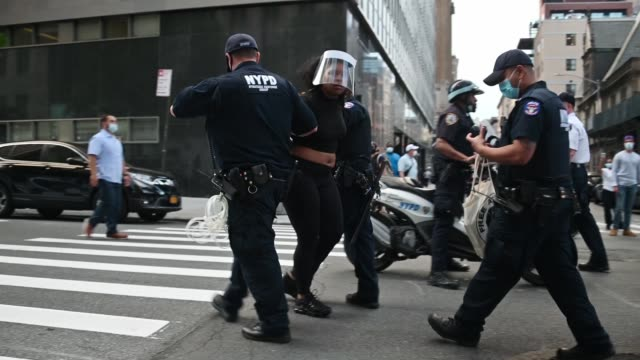police arrest protesters in front of a manhattan courthouse during a protest of the recent death of george floyd on may 29 2020 in new york city... - arrest stock videos & royalty-free footage