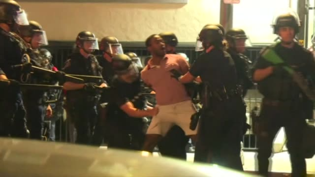 police arrest protesters in los angeles during a peaceful demonstration against george floyd's death in minneapolis, which has become a symbol of... - violence stock videos & royalty-free footage