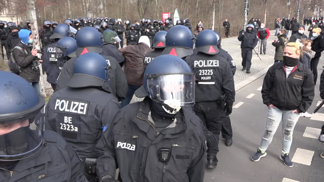 police arrest someone who had been attending a gathering of neo-nazis close to the brandenburg gate on march 20, 2021 in berlin, germany. several... - nazism stock-videos und b-roll-filmmaterial