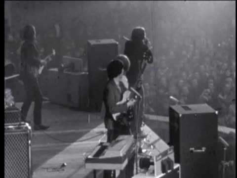 stockvideo's en b-roll-footage met police arrested 47 of the 7000 fans who turned out to see the stones and another 31 were hurt in the scrum hoses finally restored order / the rolling... - 1965