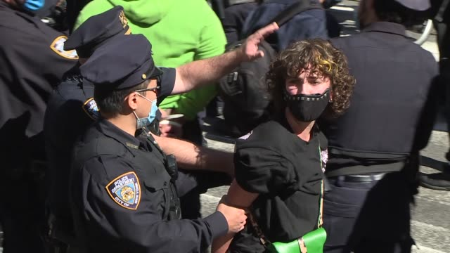 police arrested at least 50 anti-ice protestors at the iconic times square of new york city on saturday . the protesters voiced their opposition to... - arrest stock videos & royalty-free footage
