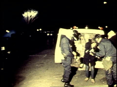 police arresting male protester / police loading prisoners in paddywagon - 1969年点の映像素材/bロール