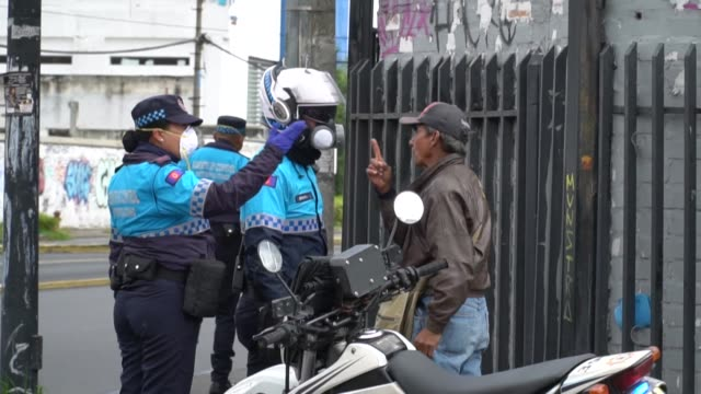 police ask people in the streets of quito to stay home and patrol the city after the government declared a state of emergency a curfew and a... - ecuador stock videos & royalty-free footage