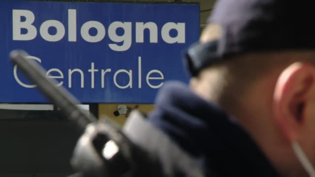 police at bologna centrale train station wearing face masks, the country is now in quarantined in lockdown due to coronavirus - train vehicle video stock e b–roll