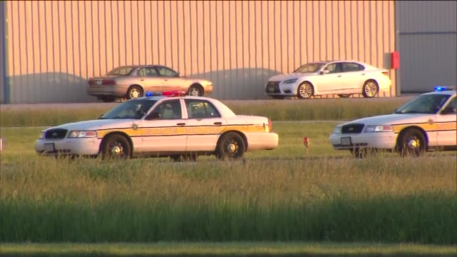 wgn police at scene at helicopter crash on june 03 2013 in lansing illinois - lansing stock-videos und b-roll-filmmaterial