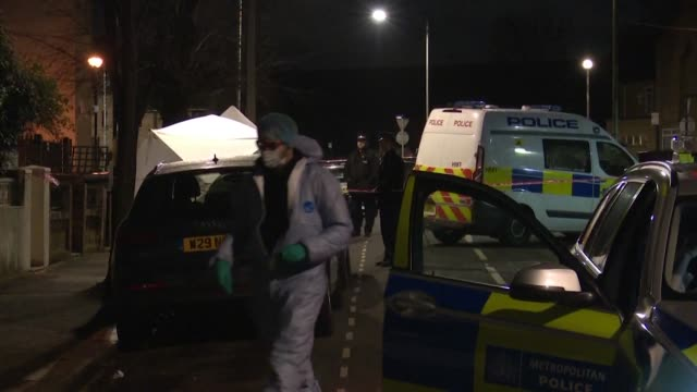 police at scene of crime where man was fatally stabbed in east london the latest victim of knife crime in the uk - stechen stock-videos und b-roll-filmmaterial