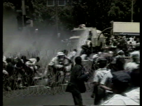 police attempt to disperse crowd by firing water cannon on demonstrators calling for release of nelson mandela - releasing stock videos and b-roll footage