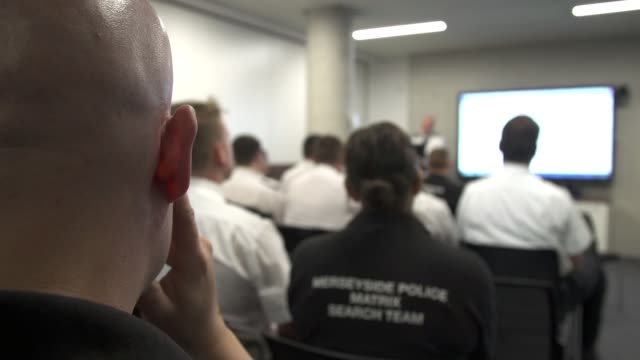 police attempting to tackle problem of 'scrambler' bikes england merseyside int back view police officers watching presentation back view officers... - badge stock videos & royalty-free footage