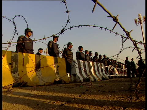 Police barricade fronted with barbed wire