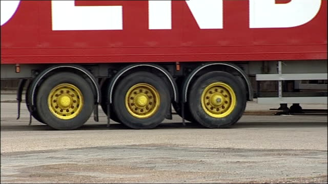police block long lorry from road trials; england: lincolnshire: lincoln: ext new 25 metre long truck and trailer combination driven along in haulage... - lincolnshire stock videos & royalty-free footage