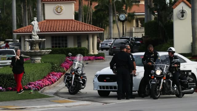 police block off the entrance to the trump national doral miami resort after a shooter opened fire on may 18 2018 in doral florida law enforcement... - doral stock videos and b-roll footage