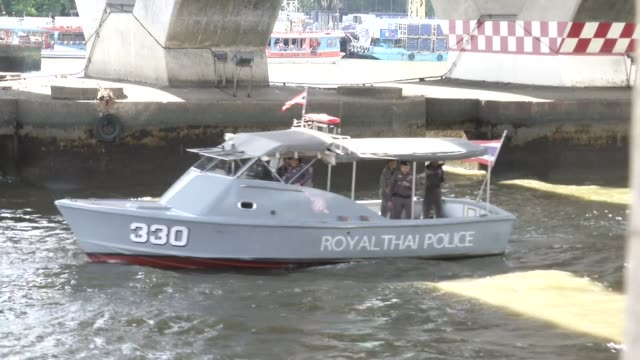 a police boat arrives to investigate a bomb thrown in a canal inlet near the saphan thaksin bts and river they prepare to drain the canal to search... - inlet stock videos & royalty-free footage