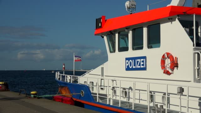 police boat at the harbour entrance of warnemuende, rostock, mecklenburg-western pomerania, germany - german culture stock videos & royalty-free footage