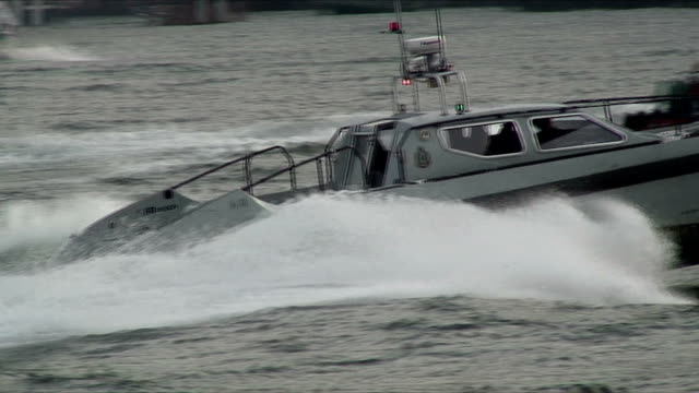 cu zo ws police boat patrolling harbor, hong kong, china - police boat stock videos and b-roll footage
