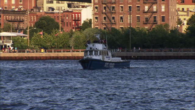 a nypd police boat patrols the east river - police boat stock videos and b-roll footage