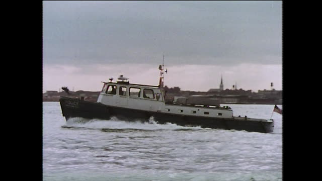 police boat patrols the waters around new york city; 1975 - police boat stock videos and b-roll footage