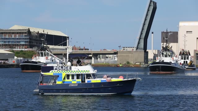 police boat protects the launch of the artful an astute class hunter killer nuclear powered submarine as it is moved from bae systems in barrow in... - torpedo stock videos & royalty-free footage