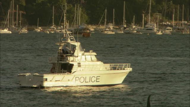 vidéos et rushes de a police boat rocks near a marina in sydney, australia. - south pacific ocean