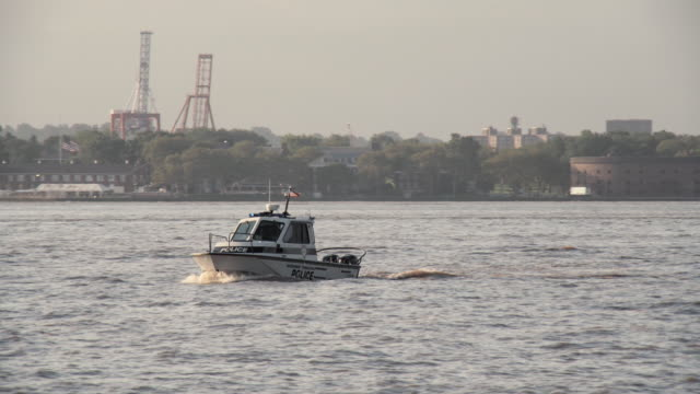 a police boat travels up the hudson river - police boat stock videos and b-roll footage