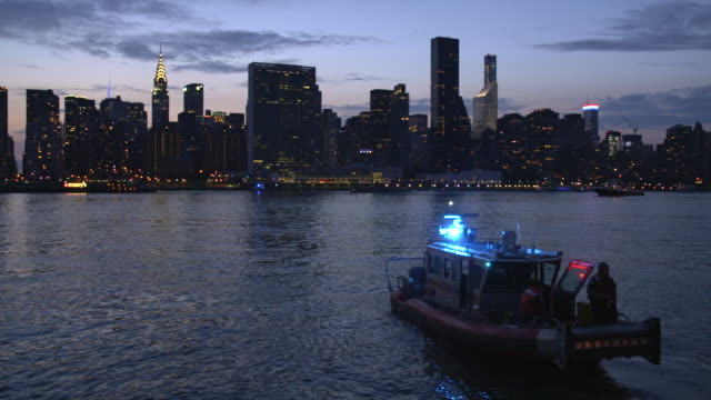 nypd police boat with manhattan skyline on the fourth of july - police boat stock videos and b-roll footage