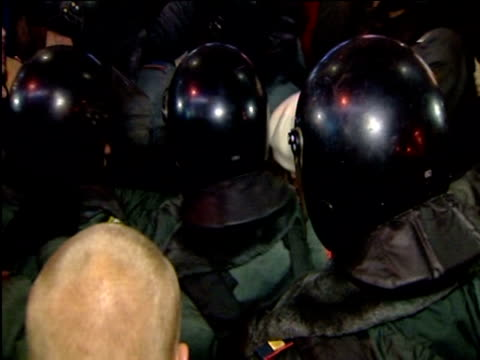 police break up a crowd of people protesting against the general election result the protestors are chanting 'russia without putin' moscow 6 dec 2011 - wladimir putin stock-videos und b-roll-filmmaterial