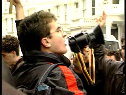 Police break up protests by ethnic Albanians Police break up protests by ethnic Albanians ENGLAND London Albanians chanting outside Yugoslave embassy...