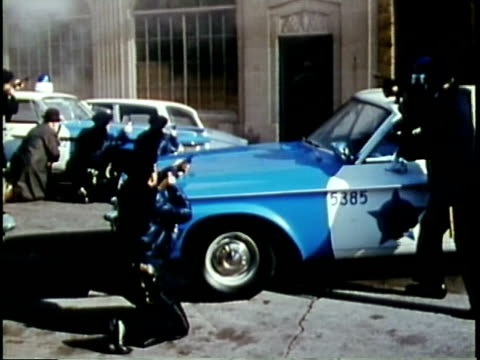 1963 montage police capture bank robber in training exercise / chicago, united states / audio - polizeiauto stock-videos und b-roll-filmmaterial