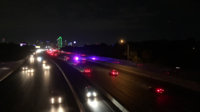 police car and evening highway traffic, dallas, texas - police force stock videos & royalty-free footage