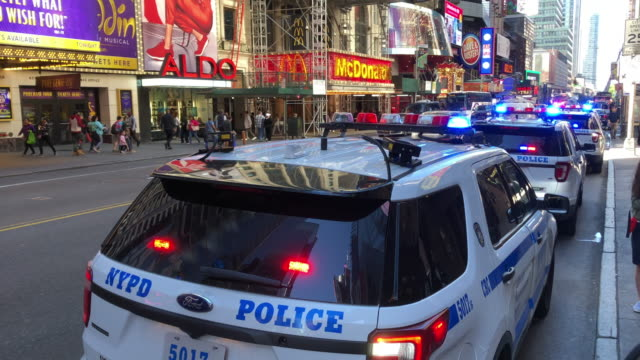nypd police car and traffic in new york city - terrorism stock videos & royalty-free footage