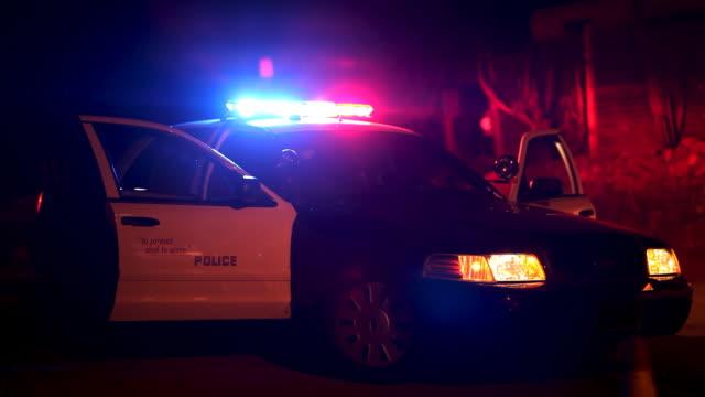police car at roadblock - lights flashing - police car stock videos & royalty-free footage