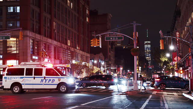 police car at six avenue. manhattan downtown and wtc in background. closed road. - ambulance stock videos & royalty-free footage