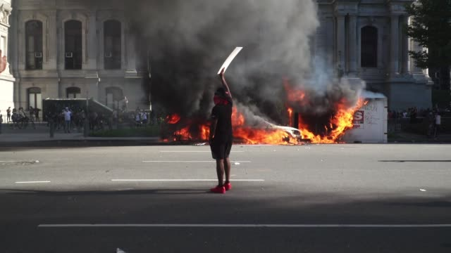 a police car burns near city hall in philadelphia on may 30 2020 during a demonstration to call for justice for george floyd a black man who died... - memorial stock videos & royalty-free footage