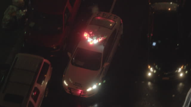 police car chasing through the streets in new york city at night. nypd crime prevention and public safety