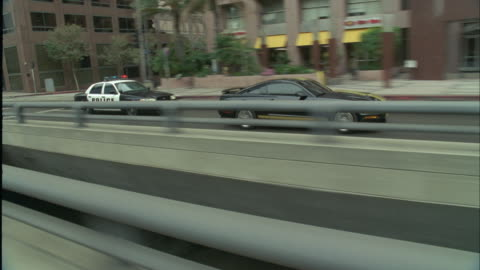 ts, zi, police car chasing vehicle on city street, los angeles, california, usa - pursuit concept stock videos & royalty-free footage