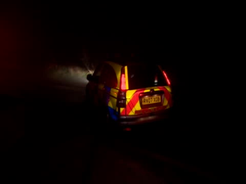a police car drives off into the night - police car stock videos and b-roll footage