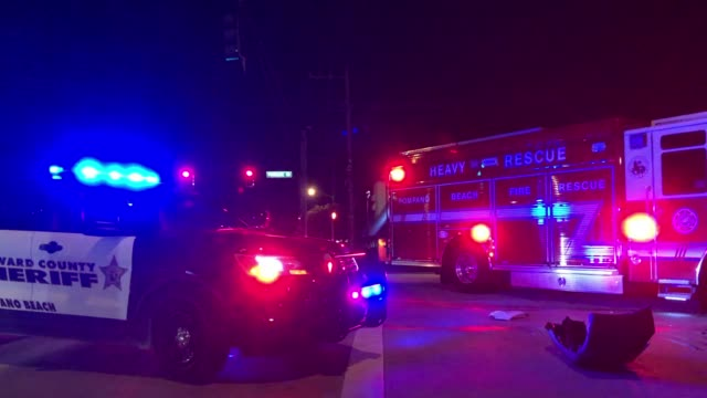 Police car, fire truck and car accident at night in Miami