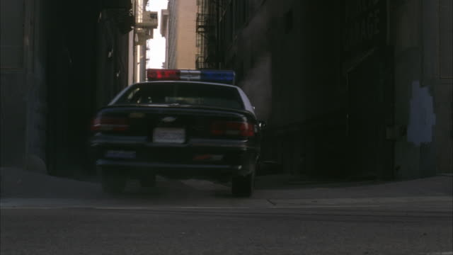 MS Police car following garbage truck / Los Angeles, California, USA