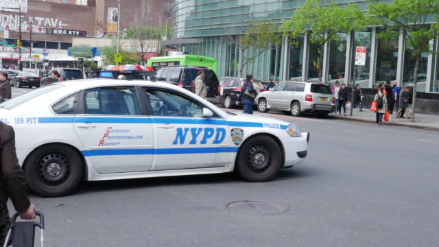nypd police car in flushing, queens, new york city - chinatown stock videos & royalty-free footage