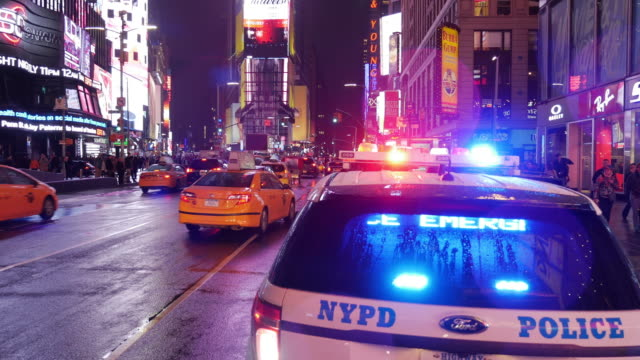 nypd police car in times square, new york city - siren stock videos & royalty-free footage