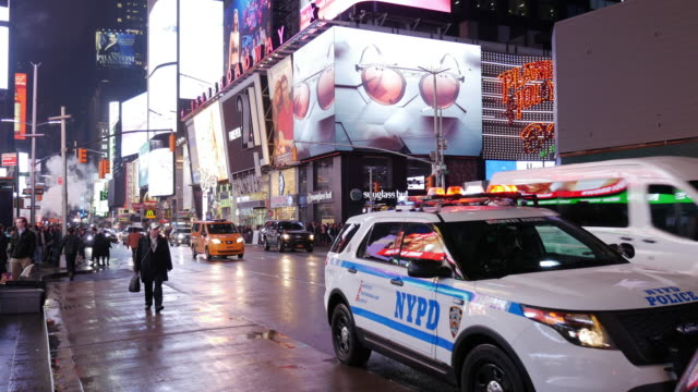 nypd police car in times square, new york city - terrorism stock videos & royalty-free footage
