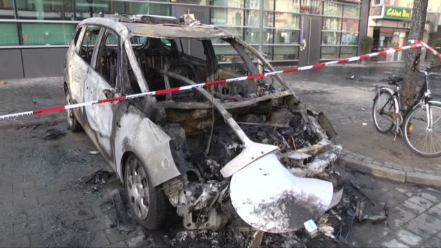 A police car is burnt during Blockupy movement protests against EU's austerity measures on the day the European Central Bank headquarters official...