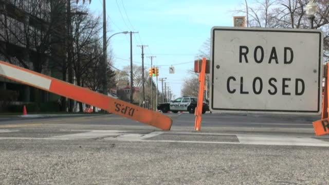 stockvideo's en b-roll-footage met police, car, law enforcement, road, closed - bord weg afgesloten