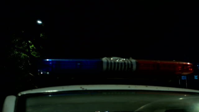 police car light glittering - police car stock videos & royalty-free footage