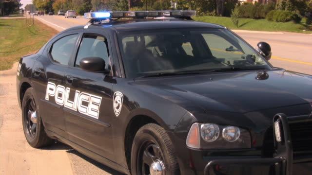 police car on traffic patrol. - police car stock videos & royalty-free footage