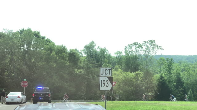 police car, road sign and ironman cyclists - chattanooga stock videos and b-roll footage