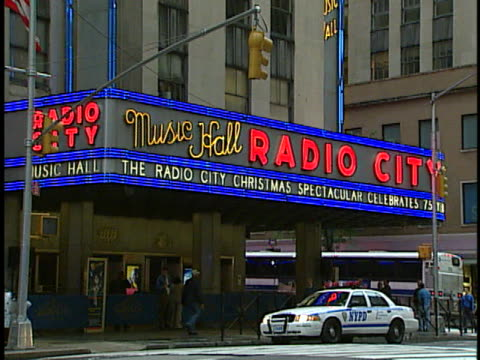 police car sits outside of radio city music hall in new york. - radio city music hall stock videos & royalty-free footage