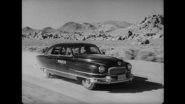 1953 a police car speeds intensely through the desert - 1953 stock videos and b-roll footage