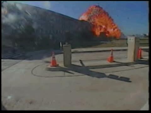 police car speeds past a barricade as a fireball destroys part of a building. - fireball stock videos & royalty-free footage