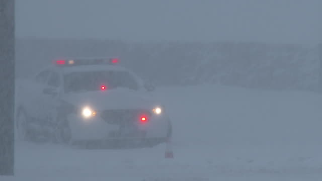 Police Car Stuck In Deep Snow During A Blizzard - Nor'easter