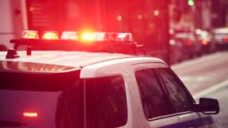 Police car with alarm and signal light flashes on the roof rush emergency call in New York City